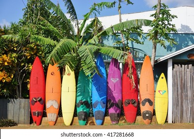 PAIA, HI -30 MARCH 2016: Colorful surfboards are lined up in the streets of Maui. Hawaii is the birthplace of modern surfing and home to the world's major big wave surfing competitions.
