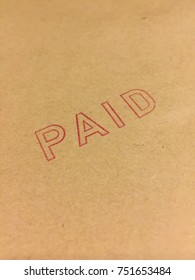 PAID stamp on craft paper