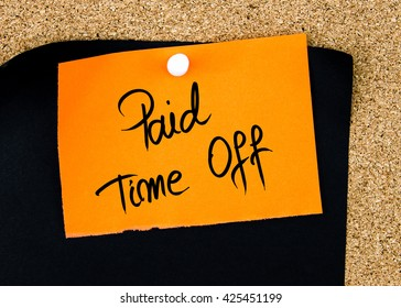 Paid Time Off written on orange paper note pinned on cork board with white thumbtacks, copy space available