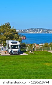 Paignton, Devon / England - 10/22/2018 : A modern motorhome is positioned to enjoy the panoramic views across Torbay from Goodrington towards Torquay in the distance. .