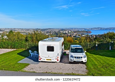Paignton, Devon / England - 10/22/2018 : A modern caravan is positioned to enjoy the panoramic views across Torbay from Beverley Park nr Goodrington towards Torquay in the distance.