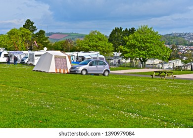Paignton,Devon / England - 5/3/2019: Caravans Tents and Motorhomes on site at Beverley Park Holiday Park near Paignton, with glorious views over Torbay towards Torquay on the English Riveriera.