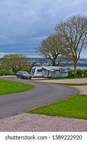Paignton,Devon / England - 5/3/2019: Modern car & caravan outfit with awning and extensions attached. With stunning views across Torbay towards Torquay.Beverley Park near Paignton.