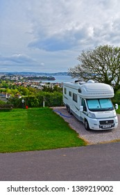 Paignton,Devon / England - 5/3/2019: A modern motorhome on a fully serviced hard-standing pitch with stunning views across Torbay towards Torquay. Beverley Park Campsite near Paignton.