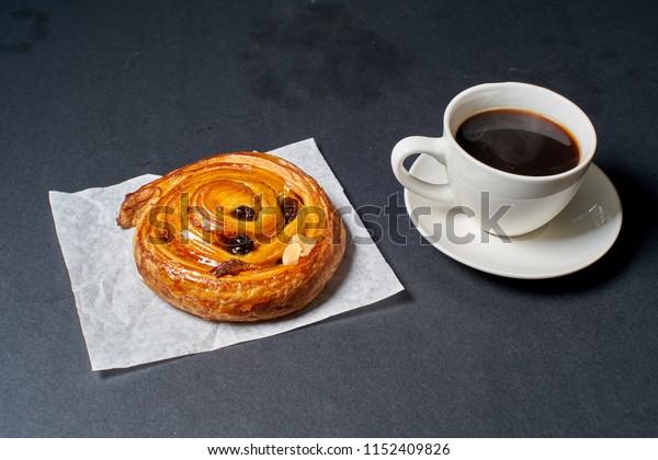 Pain aux raisins bread and black coffee