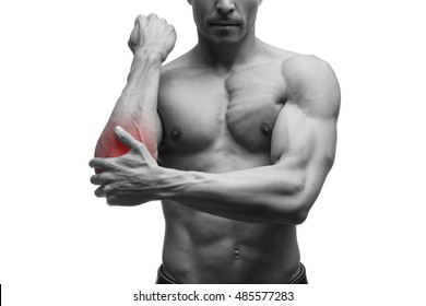 Pain in the elbow, muscular male body, isolated on white background with red dot, black and white photography