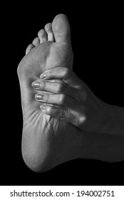 Pain in the female foot, monochrome image