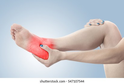 Pain in the foot. Massage of female feet. Pedicures.