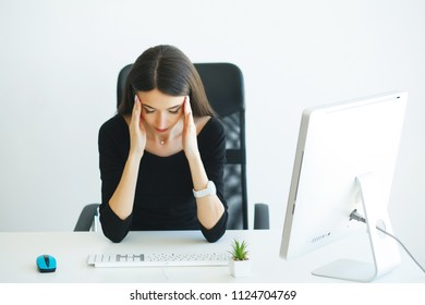 Pain. Health healthcare care concep. Portrait of sad upset accountant holding hand on head suffering from syndrome symptom head ache feeling bad sitting at desktop. Health healthcare care concept