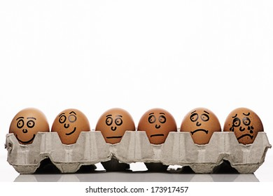 Pain intensity scale concept with copyspace and eggs characters over white background