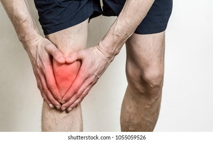 Pain in the knee of a man. Injury of the knee in the athlete. Meniscus.