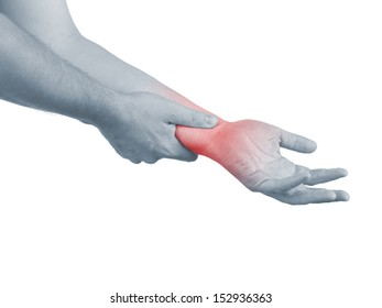 Pain in a man wrist. Male holding hand to spot of wrist pain.
