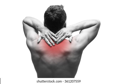 Pain in the neck. Man with backache. Muscular male body. Isolated on white background. Black and white photo with red dot