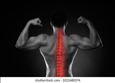 Pain in the spine, a man with backache, injury in the human back, black and white photo with highlighted skeleton