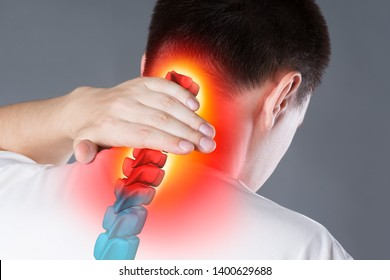 Pain in the spine, a man with backache, injury in the human neck, chiropractic treatments concept with highlighted skeleton