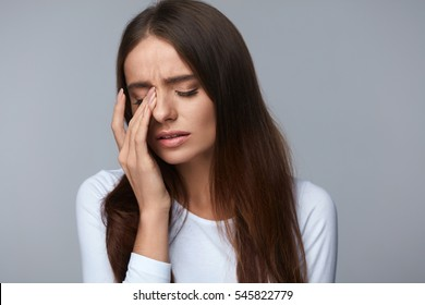 Pain. Tired Exhausted Stressed Woman Suffering From Strong Eye Pain. Portrait Of Beautiful Young Female Feeling Sick, Having Headache, Nose Pain And Touching Painful Eyes. Healthcare. High Resolution