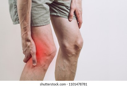 Pain under the knee of a man. Inflammatory process of the knee joint. Rupture of the meniscus.