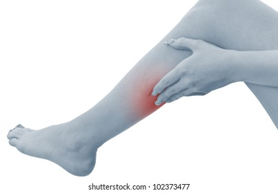 Pain in a woman calf. Female holding hand to spot of  calf-aches. Concept photo with Color Enhanced blue skin with read spot indicating location of the pain. Isolation on a white background.