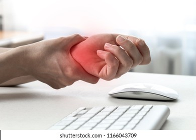 Pain in the wrist from working with a computer mouse. Carpal tunnel syndrome.