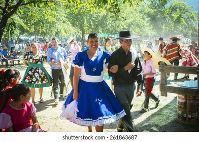 """Paine, Chile. Nov 11, 2014. Unidentified folkloric """"cueca"""" dancers during traditional festival in the Chilean countryside."""