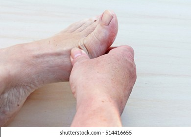 Painful feet. A woman has a pain in her feet