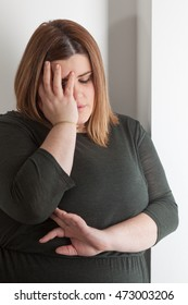 Painful woman holding her head with her hand
