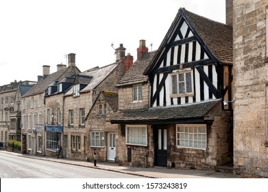 PAINSWICK, COTSWOLDS, UK - MAY 26, 2018:  Traditional and typical cottages of Painswick known as the Queen of the Cotswolds. Houses mainly built from the honey coloured Cotswold Stone, UK