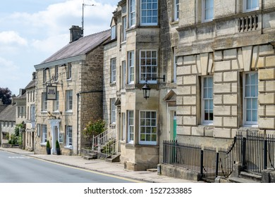 Painswick, Gloucestershire / England - July 7 2019: A view along Stroud Road / New Street / A46 including the Falcon Hotel