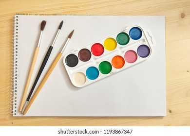 Paint brush and album. Element of design.