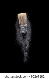 Paint brush with dust on Black background