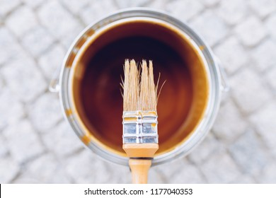 Paint brush on the can. Top view. House renovation, home improvement concept