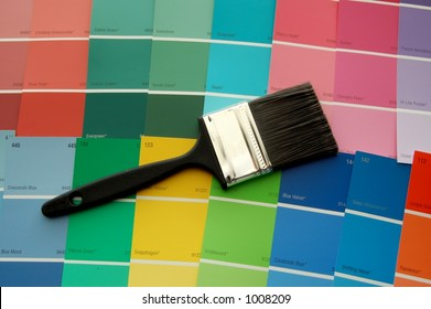 A paint brush on paint color cards