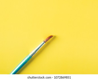 Paint brush on a colored background in pastel colors
