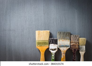 paint brush on gray plywood background.