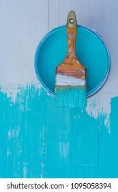 Paint brush painting  area blue on white background