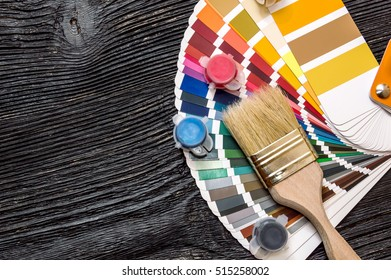 Paint Brush and paints with color swatches book