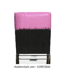 PAINT BRUSH WITH PINK PAINT ON BRISTLES