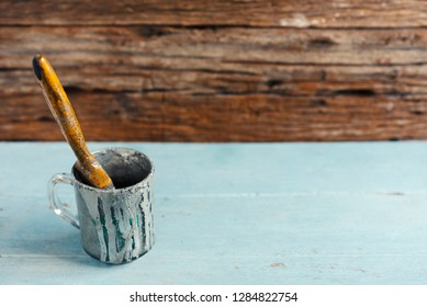Paint brush placed on a wooden table