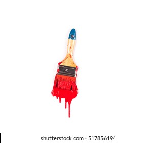 paint brush with red paint on white background, close up, top view