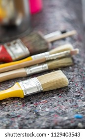 Paint, brush and tin can in artist workshop