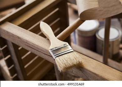 paint brush and varnish can
