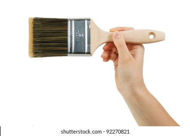Paint brush with wooden handle of a human hand