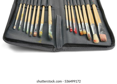 Paint brushes in a case isolated on a white background.