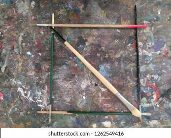 Paint brushes on old desktop