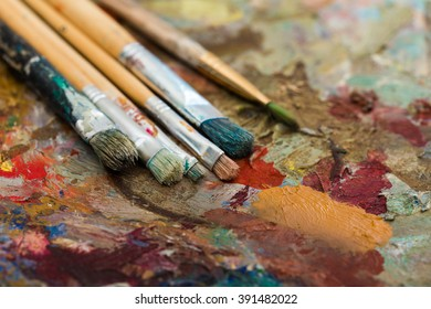paint and brushes on wooden palette