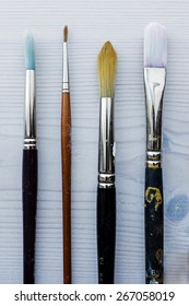 Paint brushes on a wooden table