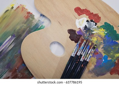 The paint brushes, palette and painting