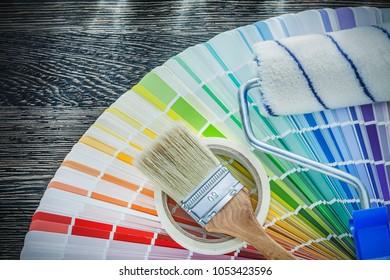 Paint brushes roller color pantone fan household tape on wood bo