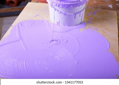 paint bucket next to paint.