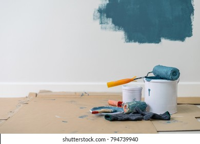 Paint bucket with roller, glove and brush, Home renovation